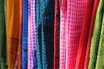 India, New Delhi. Close up of sarees for sale in Dilli Haat crafts bazaar.