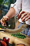 Man Chopping Fresh Herbs