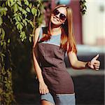 Beautiful teenage girl in sunglasses. Summer picture.