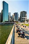 People sitting in charis on Pier 16, view toward downdown skyline, Lower Manhattan, Manhattan, New York City, New York, USA