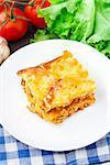Delicious Italian lasagna on a white plate