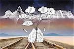 Cloud computing doodle against train tracks under energy wave in desert