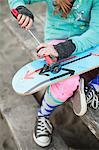 Skater girl fixes wheels