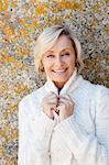 Happy Senior Woman In White Sweater