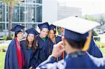 Graduate taking photograph