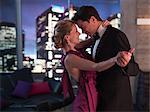 Elegant couple dancing in living room
