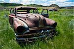 A Rusting Automobile in the Alberta Badlands.
