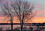 Michigan marina in winter with glowing sunset.