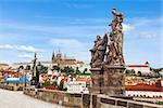 St. Thomas Aquinas and St. Dominique sculpture in the Charles Bridge in Prague, Czech Republic.