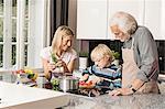 Three generation family preparing food