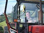 Mature farmer in tractor cab, portrait