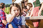 Portrait of girl at breakfast outside chalet, Tyrol, Austria
