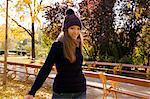 Young woman enjoying autumn in park