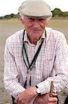 Portrait of senior man wearing flat cap