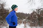 Female runner taking a break in winter scene