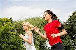 Women jogging through park