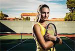 Female tennis player holding racket