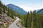 Cyclists on winding highway, Aspen, Colorado, USA