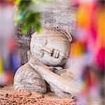 Buddhist prayer flags and reclining Buddha in Nirvana at Gal Vihara Rock Temple, Polonnaruwa, UNESCO World Heritage Site, Sri Lanka, Asia