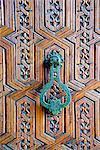 Detail of a wooden door and bronze knocker, Islamo-Andalucian art, Marrakech Museum, Marrakech, Morocco, North Africa, Africa