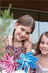 Girls holding pinwheels