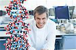 Scientist with molecular model in lab