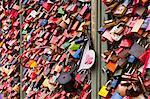 Love locks on the railway bridge in Cologne, North Rhine-Westphalia, Germany, Europe