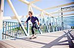 A young man riding a skateboard in a urban area.