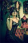 Neo baroque woman sitting in black dress