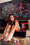 Young woman sitting on sofa wearing socks