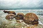 Moeraki Boulders on the Koekohe beach, Eastern coast of New Zealand. HDR image