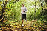 Man jogging in woods