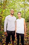 Couple standing in woods