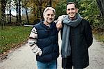 Two male friends posing in woods
