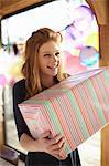 Portrait of  teenage girl holding large birthday gift