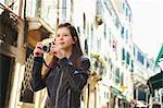 Girl exploring with camera, Venice, Italy