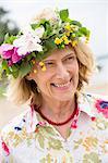 Mature woman wearing flower wreath, Nykoping, Sodermanland, Sweden