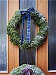 Christmas wreath hanging on door, Varmdo, Uppland, Sweden