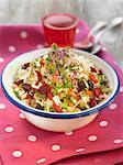 Rice tabbouleh with peas,sugar peas,goji beans and raisins