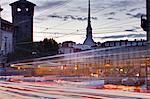 Traffic rushes through Piazza Castello, Turin, Piedmont, Italy, Europe