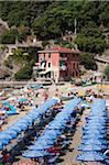 Striped umbrellas on beach, Riviera di Levante, Cinque Terre, Corniglia, Liguria, La Spezia Province, Monterosso, Italy