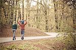 Parents with son walking across road, Osijek, Croatia
