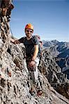 Male alpinist rock climbing, Innsbruck route, Tyrol, Austria
