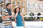 Tourist couple enjoying ice cream cones during vacation
