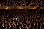 Spotlight on audience members in theater
