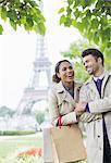 Couple walking in park near Eiffel Tower, Paris, France