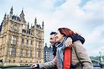 Mature couple sightseeing on Thames boat, London, UK