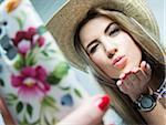 Young Woman taking Selfie, Studio Shot
