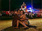 Happy couple hugging outside music festival