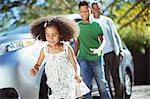 Family running outside car